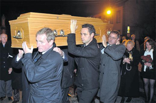 Taoiseach, Enda Kenny with his nephew Henry junior, and his brother Henry, carry the coffin at the removal of his mother Eithne