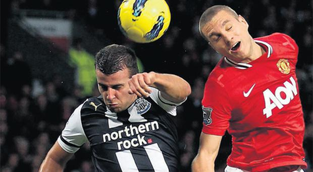 Manchester United defender Nemanja Vidic beats Newcastle's Steven Taylor to a header during their game at Old Trafford on Saturday