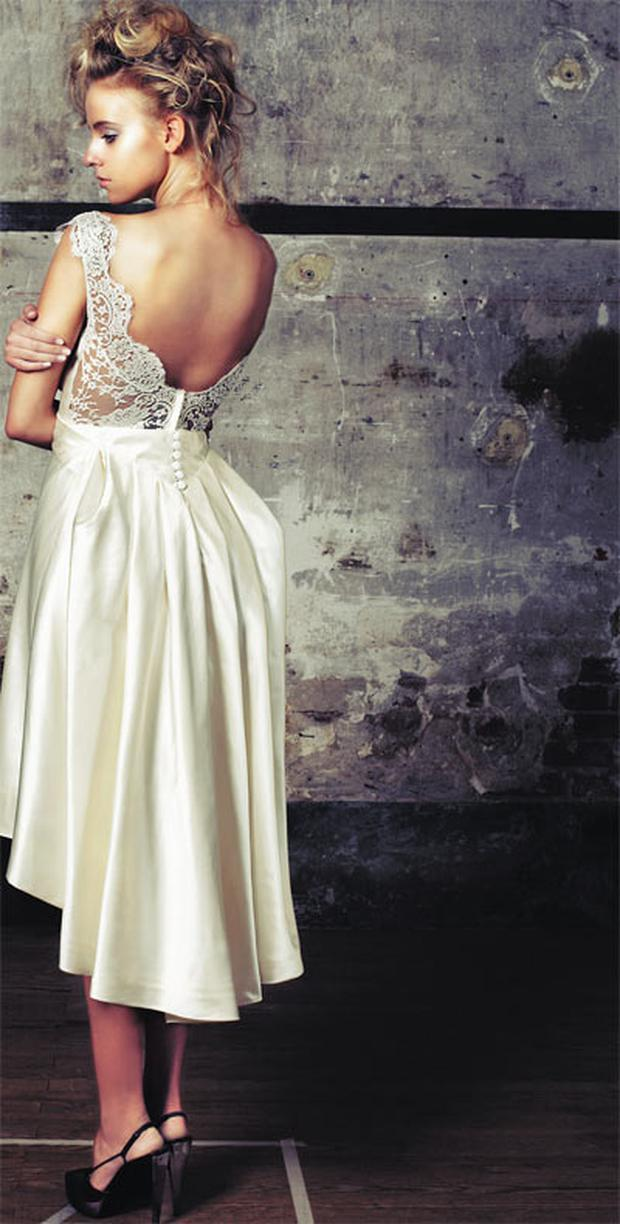 Duchesse-silksatin gown, with pleated bustle, boat-neck and lace back, €1,550. Shoes, stylist's own