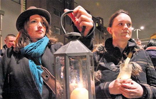 Sinead McCormack and Siobhan Ryan, residents of Priory Hall, at the candlelit vigil held last night