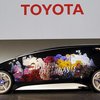 Toyota's new concept car resembles a giant smartphone to demonstrate how the company is trying to take the lead in technology (AP)