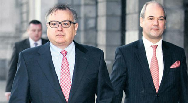 Mike Aynsley (left), CEO of the Irish Bank Resolution Corporation (IBRC), and Richard Woodhouse, executive director of corporate projects at IBRC, leaving court yesterday after the Sean Quinn judgment hearing