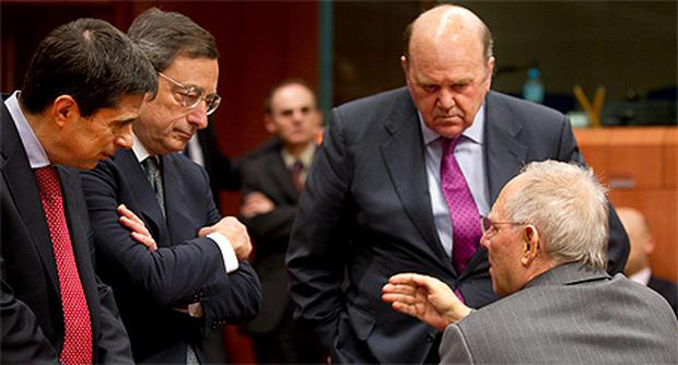 From left: Portuguese Finance Minister Vitor Gaspar, ECB president Mario Draghi, Irish Finance Minister Michael Noonan and his German counterpart Wolfgang Schauble at the Eurogroup meeting in Brussels yesterday