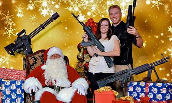 Father Christmas with a couple from the Scottsdale Gun Club in Arizona. Photo: Scottsdale Gun Club