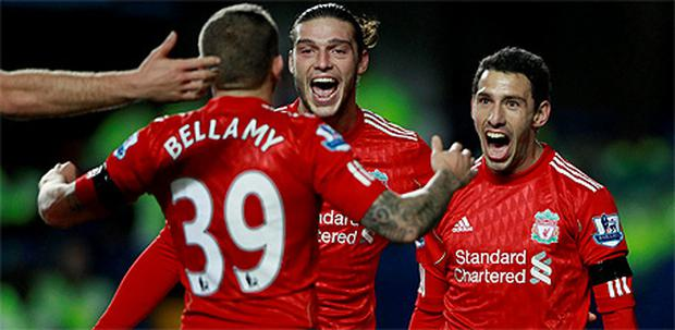 Liverpool's Maxi Rodriguez (right) celebrates with Any Carroll and Craig Bellamy