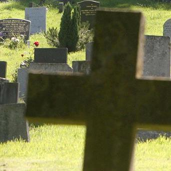 Gravediggers in Pittsburgh are accused of jumping up and down on a coffin to make it fit into a tight hole
