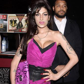 Amy Winehouse's family have given their blessing for a new album to be released