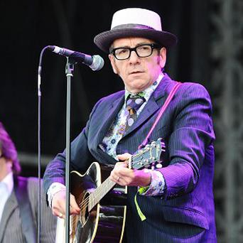 Elvis Costello has told fans not to buy his new album