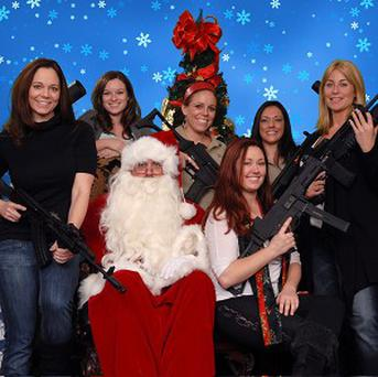 Santa and some of his machine-gun toting helpers in a US gun club photo shoot (AP)