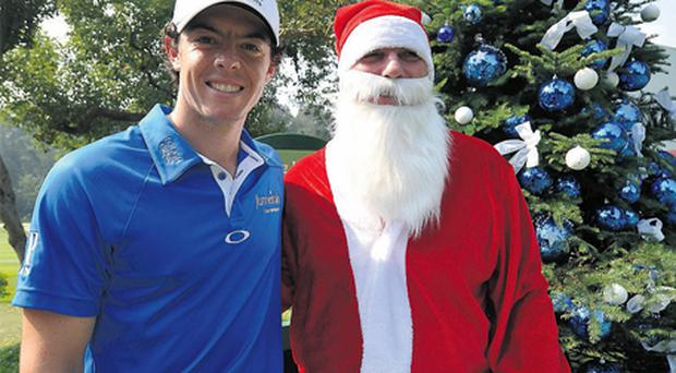 Rory McIlroy greets Father Christmas before yesterday's Pro-Am at the UBS Hong Kong Open. Photo: Getty Images