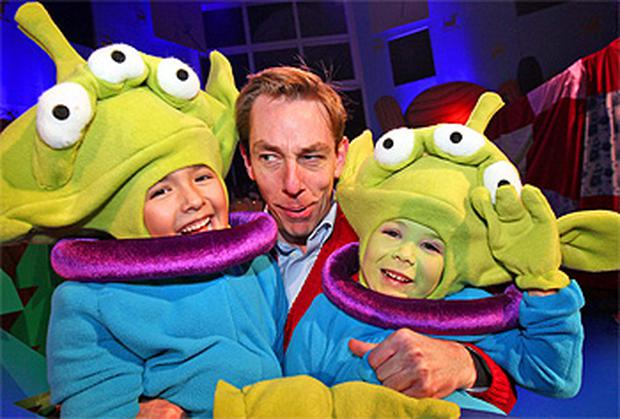 Ryan Tubridy with Aliens, Ciaran Magbohus (6) from Navan and Dylan O'Connor (4) from Artane who will be taking part in The Late Late Show's annual toy show tonight