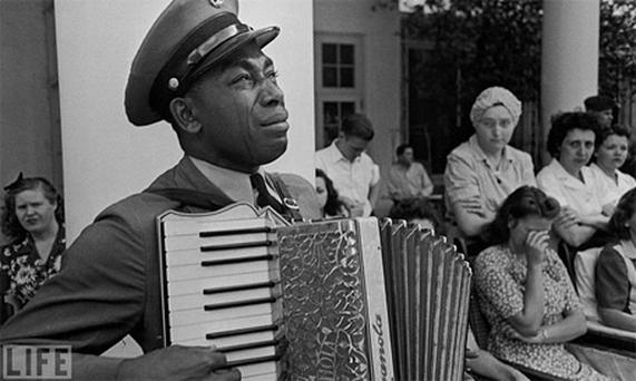 Navy Chief Petty Officer Graham Jackson had played the accordion often for Franklin D. Roosevelt during the polio-stricken president's frequent visits to the spa at Warm Springs, Ga. He was scheduled to play for him again on April 12, 1945, the day Roosevelt died at the LIttle White House in Warm Springs. Instead, the officer found himself leading the funeral procession the next day, tears streaming down his face. By Ed Clark. Photo: LIFE.com