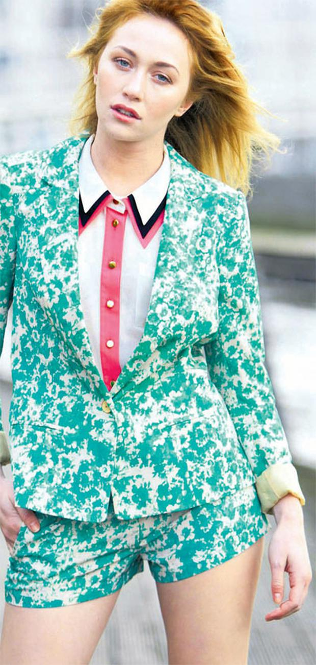 January wears a printed jacket, triple collar blouse and shorts from Penneys