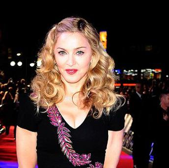 Madonna has made peace with a neighbour who complained about the noise coming from her apartment