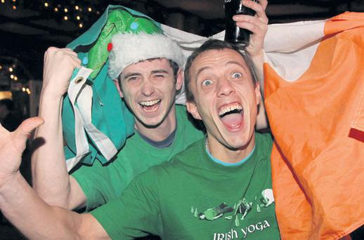 Ireland fans Colin Doyle and Gary Edwards celebrate the the Republic of Ireland's draw for Euro 2012 group stages last night in Baker's Corner Pub in Deansgrange, Dublin. Photo: COLLINS