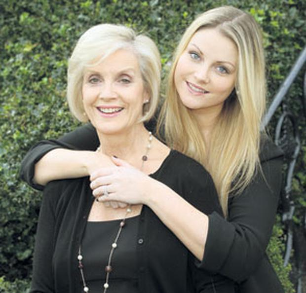 IN STEP: Mother and daughter Alma Carroll and Jess Ryan share many common traits. They both lost their hearts at 17 and share a love of musicals, but Jess has also inherited a flair for business from her father Arthur Ryan, founder of Penneys. Photo: Tony Gavin