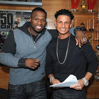 50 Cent, left, has signed up Jersey Shore star Pauly D for his record label (AP)