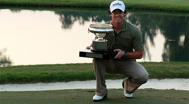 Rory McIlroy poses with the trophy after winning the Hong Kong Open