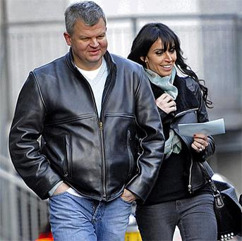 Flying low: Adrian Chiles leaves ITV studios with Christine Bleakley