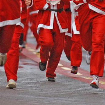 A newly married couple took part in a charity race dressed as Santas a year after meeting at the event
