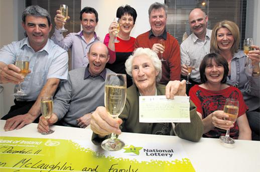 The latest Lotto millionaire, 77-year-old Kathleen McLaughlin, and her family from Moville, Co Donegal, collecting her win of €2,642,046 at the National Lottery Offices on Dublin's Lower Abbey Street yesterday
