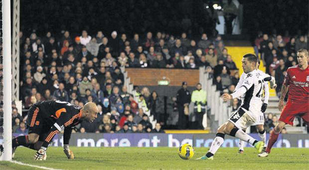 Clint Dempsey scores the only goal of the game for Fulham after Liverpool's Pepe Reina fumbled that ball at Craven Cottage last night