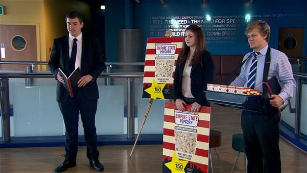 Team Atomic pitch their brand of popcorn to a chain of cinemas