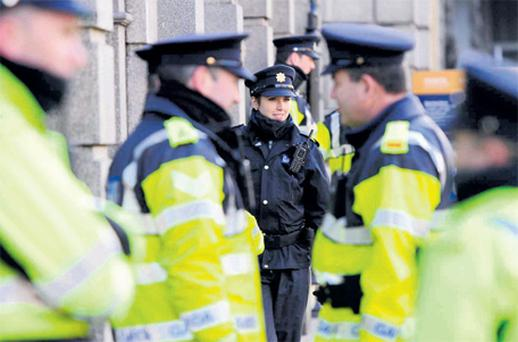 Gardai on duty outside Leinster House as Minister Howlin announced his cuts