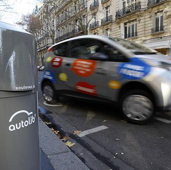 A noiseless electric car has knocked over a pedestrian in Paris who apparently did not hear it coming (AP)