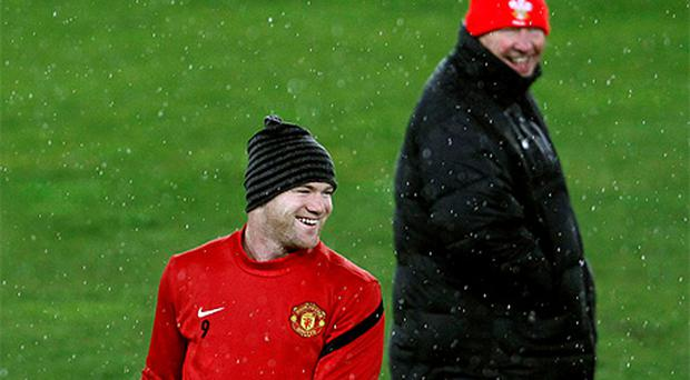 Wayne Rooney and Alex Ferguson share as United train ahead of their Champions League clash with Basel