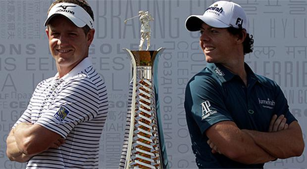Luke Donald and Rory McIlroy pictured with the Race to Dubai trophy