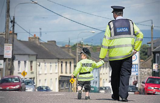The photo of his father Larry and son Ben (5) in matching garda uniforms, which received a special commendation. Photo: Mark Condren