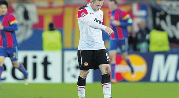Wayne Rooney shows his disappointment as Manchester United crash out of the Champions League in Basel last night