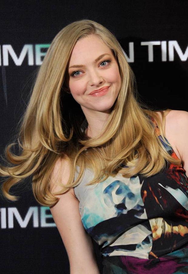 Amanda Seyfried says her signature tresses benefit from less frequent washing and use of dry shampoo. Photo: Getty Images