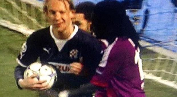 Suspicious behaviour? Dinamo Zagreb's Domagoj Vida was seen winking after Lisandro Lopez scored Lyon's fifth goal