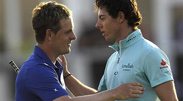 Luke Donald and Rory McIlroy pictured at the end of their first round at the Dubai World Championship