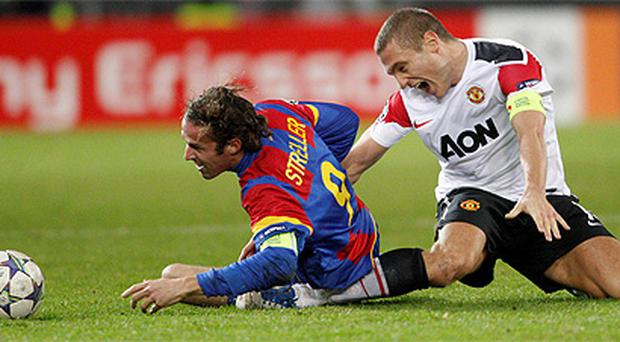 Vidic is injured in Champions League defeat