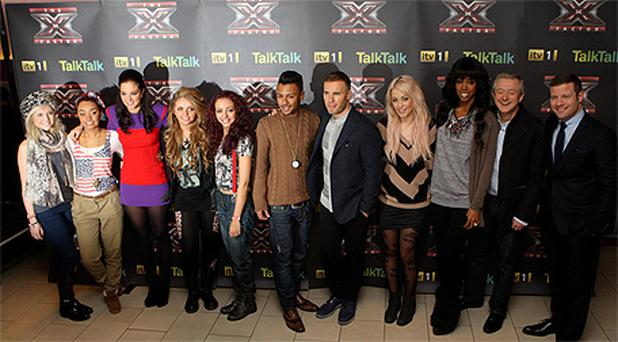 The X Factor finalist pictured with judges and the show's host Dermot O'Leary
