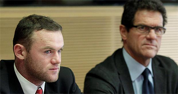 England striker Wayne Rooney and manager Fabio Capello at an appeal hearing at the Disciplinary Commission at the UEFA headquarters in Nyon