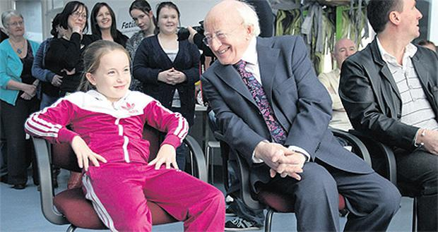 Megan Reid, 10, from Rialto, chats with President Michael D Higgins before the President viewed a video, in which Megan featured, at the F2 Centre at Ruben Plaza, Rialto yesterday