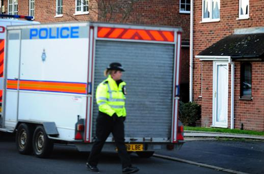 Police at the scene in Melton Mowbray. Photo: PA