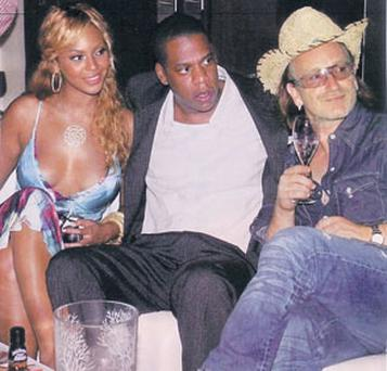 Beyonce with husband Jay-Z and Bono