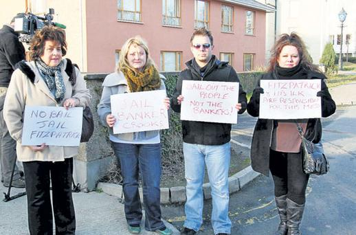 A group of anti-banker protesters outside the garda station in Bray