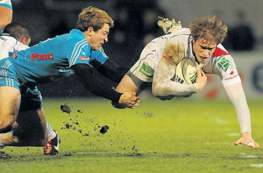 Ulster's Andrew Trimble is upended by the tackled of Aironi Giulio Toniolatti during last night's Heineken Cup Pool 4 clash at Ravenhill. Photo: OLIVER MCVEIGH / SPORTSFILE