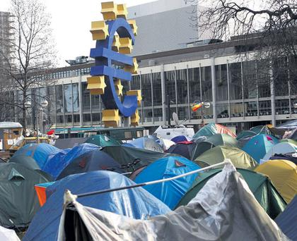 Tents of the 'Occupy Frankfurt' movement in front of the ECB headquarters during a protest. Photo: REUTERS/ALEX DOMANSKI