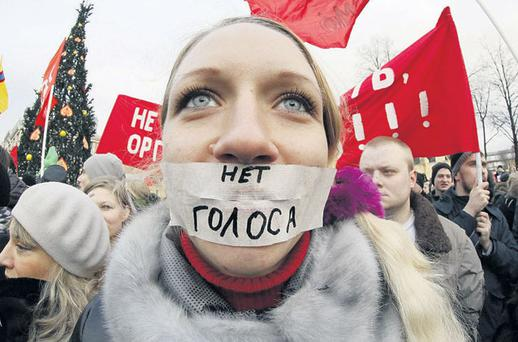 PUBLIC OPINION: A protester at a rally in St Petersburg, Russia, yesterday. The sign over her mouth translates as 'No vote'