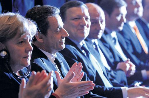 THEIR RULES: The real power is in the hands of Angela Merkel, Nicolas Sarkozy and Eurocrats such as Jose Manuel Barroso
