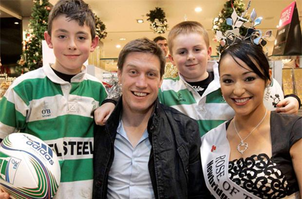 Ireland's Ronan O'Gara and the Rose of Tralee Tara Talbot in the Dundrum Town Centre yesterday with 10-year-old Ciaran Flynn, left, and 10-year-old Luke Coy