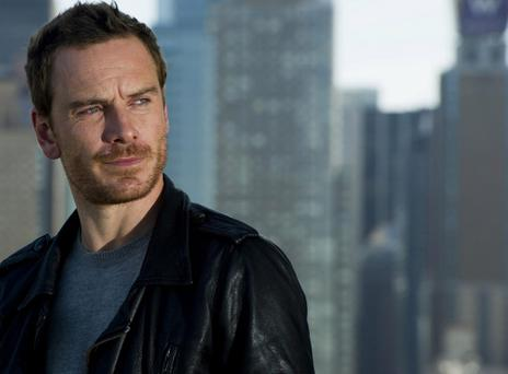FILE - In this Oct. 7, 2011, file photo, actor Michael Fassbender poses for a portrait in New York. Fassbender was named best actor in the L.A. Critics Awards Sunday, Dec. 11, 2011, for his roles in 'A Dangerous Method,' 'Jane Eyre,' 'Shame' and 'X-Men: First Class.' (AP Photo/Charles Sykes, File)