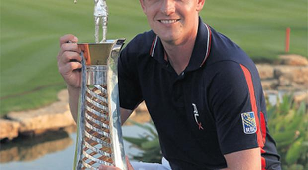 Luke Donald with the Race to Dubai Trophy after finishing third in the Dubai World Championship to secure his Order of Merit title on the Earth Course at the Jumeirah Golf Estates in Dubai